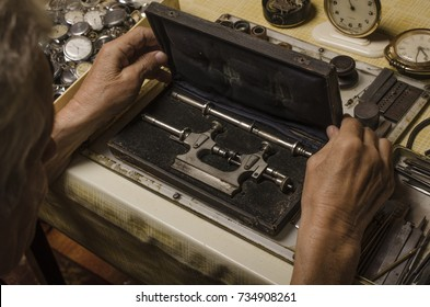old watchmaker at work