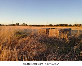 Old water ditch. Surface irrigation. Irrigated land in the center of the Iberian Peninsula. Agricultural industry in the extreme southwest of Europe. Crop furrow irrigation system.