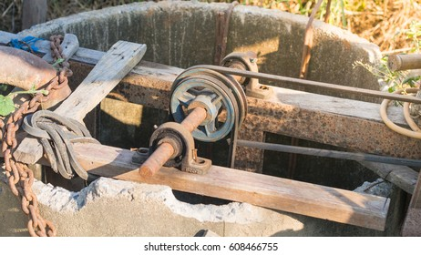 Old water machine Thailand with concrete pond