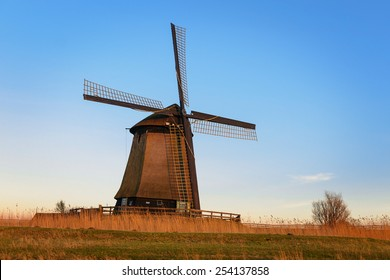 Old water mill beside Eilandspolder in evening light, the Netherlands