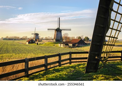 Old water mills beside Eilandspolder in evening light, the Netherlands