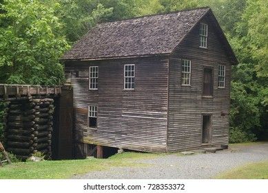 Old water powered wood  slat Grist Mill and log water trough.