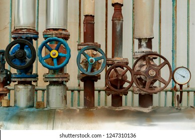 old water steam leak valve in old industry factory