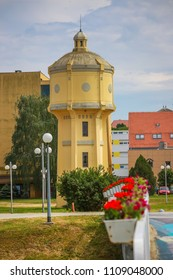 Old water tower with lined up flower on the pedestrian bridge in the Vukovar, Croatia.