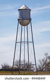 an old water tower on a farm