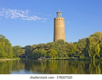 Old water tower seen across pond in the Maria Hendrika park in Ostend, Belgium
