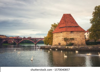 Old Water tower (Vodni stolp) in Maribor city, Slovenia. Scenic view of medieval fortified tower, Old (State) bridge and swans on the Drava river, popular tourist destination, travel background - Shutterstock ID 1570040857