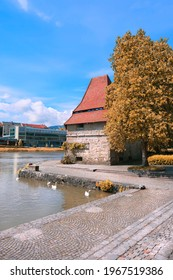 Old Water tower Vodni Stolp in Maribor city in Slovenia. Medieval tower and swans on the Drava river in Autumn. - Shutterstock ID 1967519386