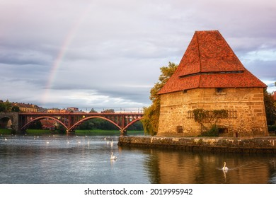 Old Water tower (Vodni stolp), Maribor city, Slovenia. Scenic view of medieval fortified tower, Old (State) bridge, rainbow and swans on the Drava river, popular tourist destination, travel background - Shutterstock ID 2019995942