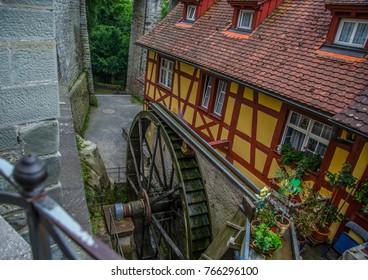 Old water wheel in the town of Meersburg in Germany