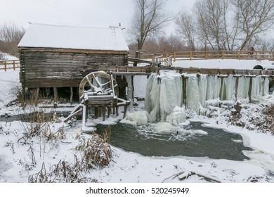 Old watermill in Krasnikovo, Kursk region. Winter, watermill is frozen in ice