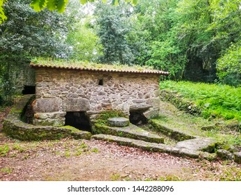 Old watermill on Armenteira riverbank forest in Ribadumia town, Galicia, Spain
