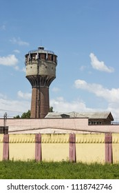 Old water-pressurer tower on territory of factory in provincial town. Russia