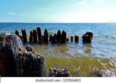 Old wave beaten pylons which were once a pier now become a beautiful scene of nautical historic vision alone  Little Bay De Noc near Gladstone Michigan along the shores  Lake Michigan and Green Bay.  - Shutterstock ID 1570556851