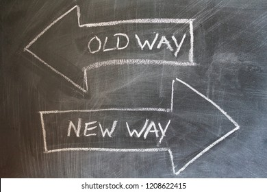 Old way, new way written on chalkboard. Change concept