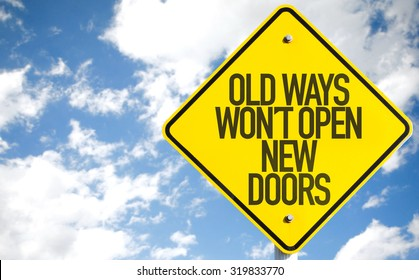 Old Ways Wont Open New Doors sign with sky background