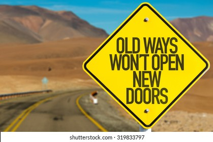 Old Ways Wont Open New Doors sign on desert road