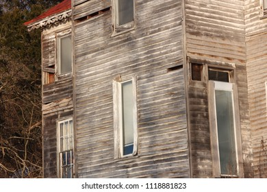 Old, weathered, abandoned house with windows