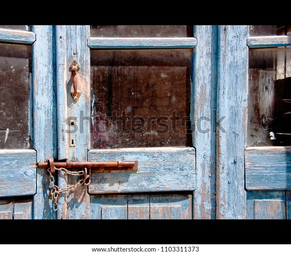 old weathered blue painted frame