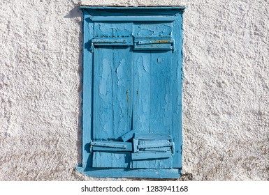 Old weathered blue window.Stock Image