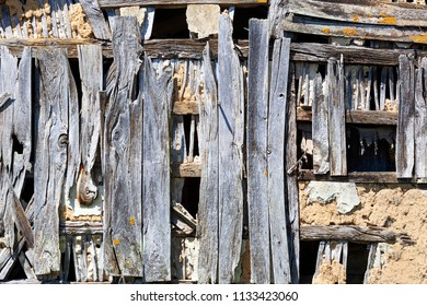 Old weathered blue wooden construction in France background