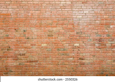 An old weathered brick wall; exposed brickwork