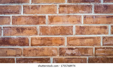 Old weathered brown-red brick wall