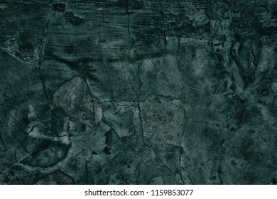 Old weathered concrete wall teal blue color. Gloomy dark grunge background