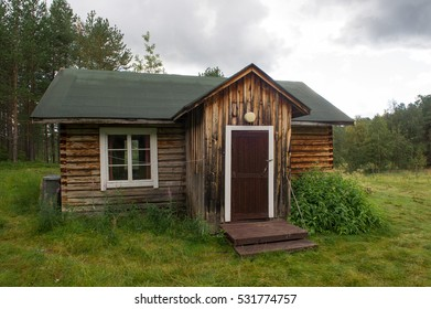 old weathered cottage in a rural scandinavian landscape