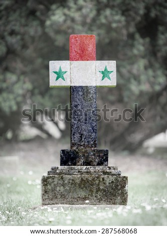 Old weathered gravestone in the cemetery - Syria