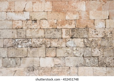 Old and weathered large stone blocks wall texture