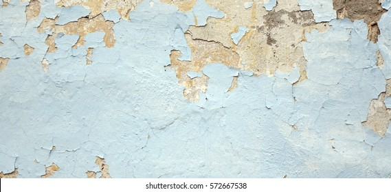 Old Weathered Painted Blue Plastered Peeled Interior Wall Background.  Cracked Flaked Shabby Wall With Rundown Stucco Layer Texture. Abstract Blue White Horizontal Empty Wallpaper. Abstract Web Banner