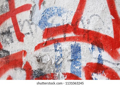 old weathered peeling graffiti street art paint on urban wall in downtown berlin