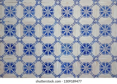 Old Weathered Portuguese Blue Azulejo Ceramic Tiles On An Exterior Wall Of A Building