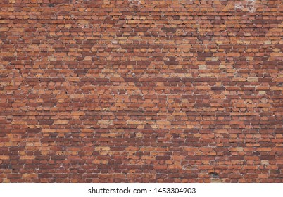 Old weathered red brick wall. High resolution seamless texture for background, pattern, poster, collage, gift wrap, wallpaper, photo layering etc.