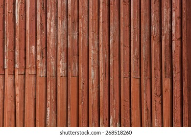 Old and weathered red painted wooden wall