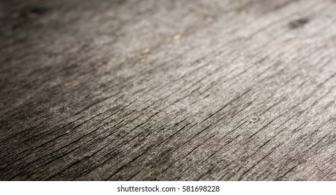 Old Weathered Rotten Cracked Knotted Coarse Wood Gray Grunge Texture.