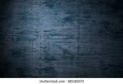 Old weathered rustic dark blue brick wall with scratches