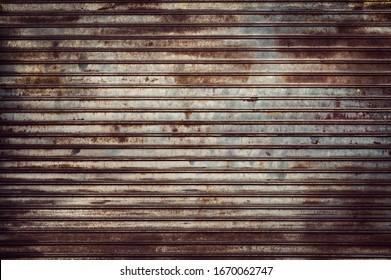 Old weathered and rusty steel door for steel metal backgroud and texture.