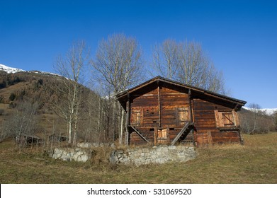 Old weathered shed in a rural landscape