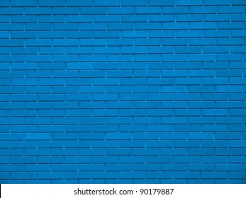 Old weathered stained blue brick wall background