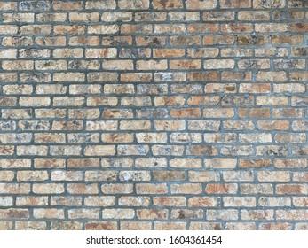 old weathered stone brick block wall