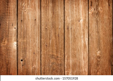 old weathered and textured wooden boards on a barn door