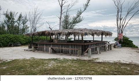 Old Weathered Tiki Bar on a Beach