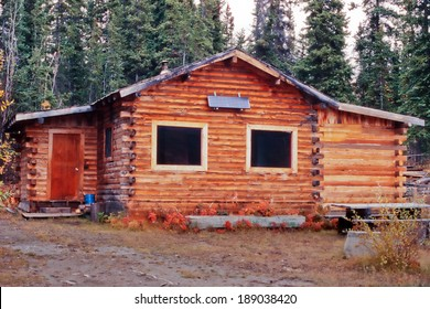 Old weathered traditional Yukon log cabin with exterior off-grid solar panel in the boreal forest taiga of Yukon Territory, Canada