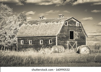 An old weathered vintage barn abandoned on the prairies. Processed with an infrared monochrome filter.