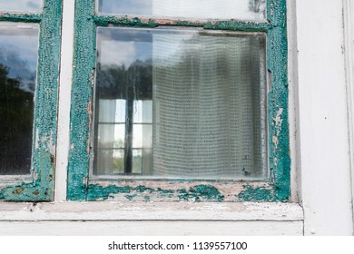 Old weathered window in great need of maintenance