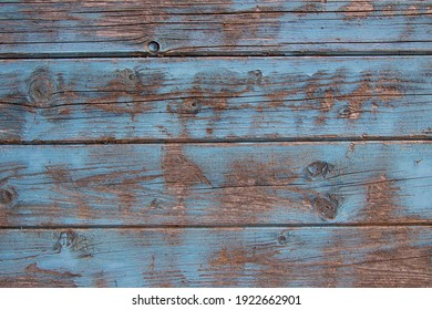 Old weathered wood plank texture with light blue paint for background with copy space