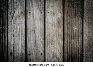 Old weathered wood planks outside flooring teak texture background. Wooden pattern of antique ribbed wooden planks for construction deck or indoor floor.