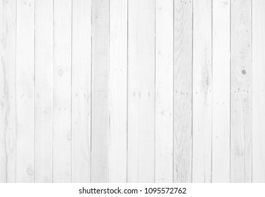 Old weathered wood surface with long boards lined up. Wooden planks on a wall or floor with grain and texture. Light neutral flat faded tones.